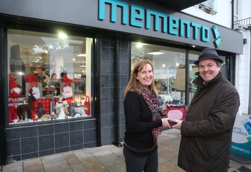 Memento on Causeway Street Portrush was the winner of Causeway Coast and Glens Borough Council's Christmas window competition in Portrush. Maggie Sutherland is pictured receiving the award from Town and Village Officer Shaun Kennedy.