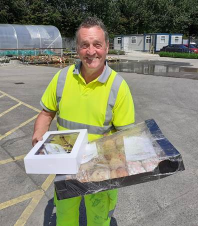Causeway Coast and Glens Borough Council Operations employee George Elliott pictured with scones and tray bakes which were delivered to Limavady Depot by Roe Rover Football Club as a token of thanks for frontline workers earlier this year.