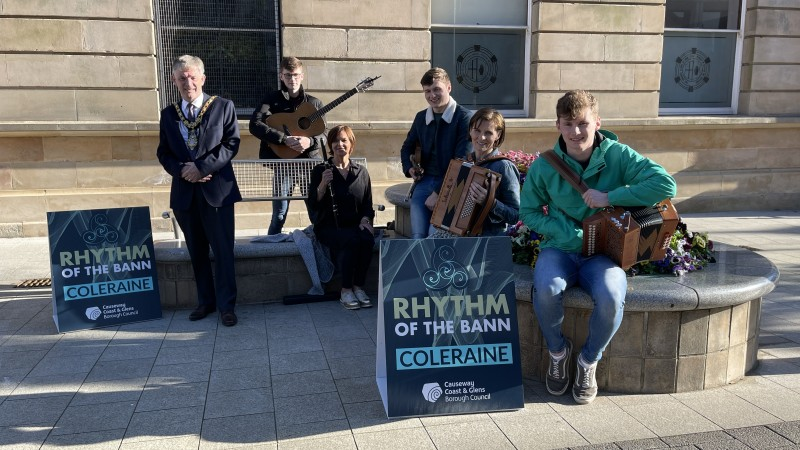 The Mayor of Causeway Coast and Glens Borough Council Alderman Mark Fielding pictured in Coleraine town centre with Dee Tasker and Friends who will perform during the virtual Rhythm of the Bann.