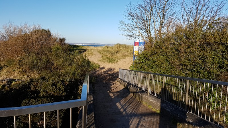 Pedestrian access to beach via footbridge over River Margy