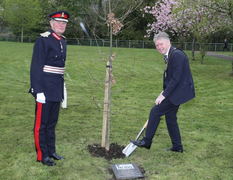 The Mayor of Causeway Coast and Glens Borough Council Alderman Mark Fielding plants a native oak tree at Riverside Park in Ballymoney along with the Lord-Lieutenant for County Antrim Mr David McCorkell.