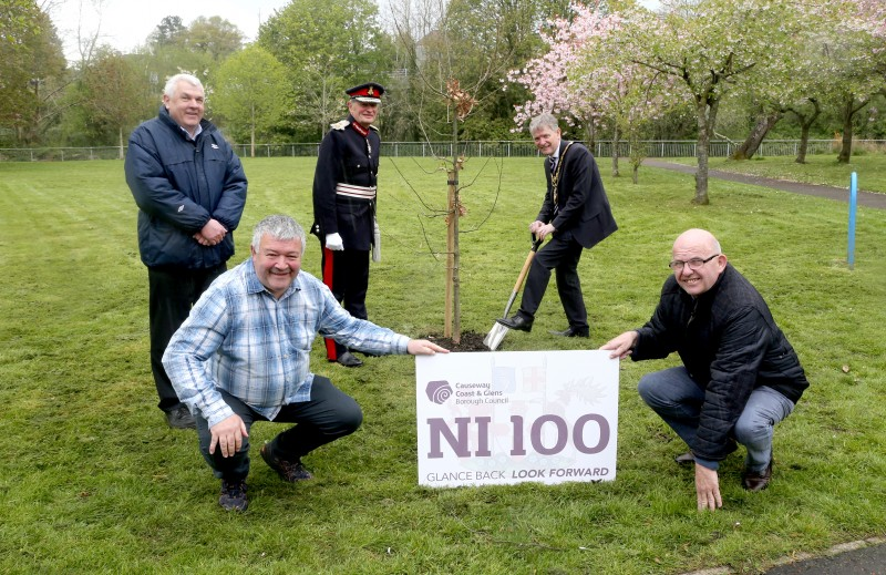 The Mayor of Causeway Coast and Glens Borough Council Alderman Mark Fielding plants a native oak tree at Riverside Park in Ballymoney along with the Lord-Lieutenant for County Antrim Mr David McCorkell, Councillor Alan McLean, Councillor Ivor Wallace and Alderman John Finlay.