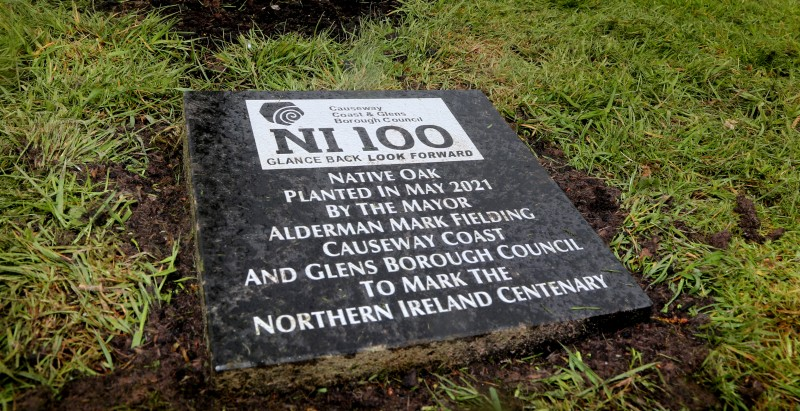 The native oak trees are accompanied by this commemorative plaque.