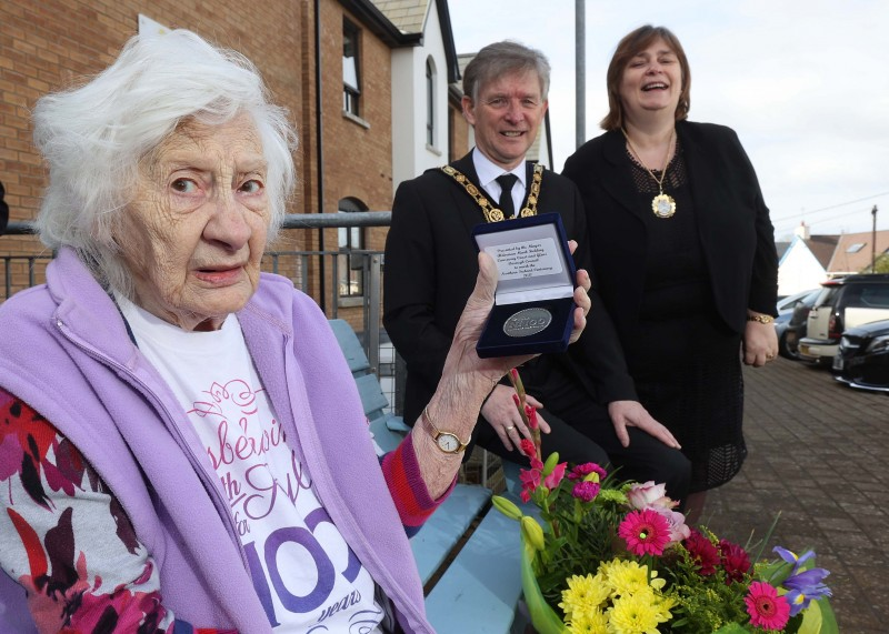 Bertha Fearson, who celebrated her 100th birthday on 11th February 2021, displays her commemorative centenary coin received from the Mayor of Causeway Coast and Glens Borough Council Alderman Mark Fielding and Mayoress Mrs Phyllis Fielding.