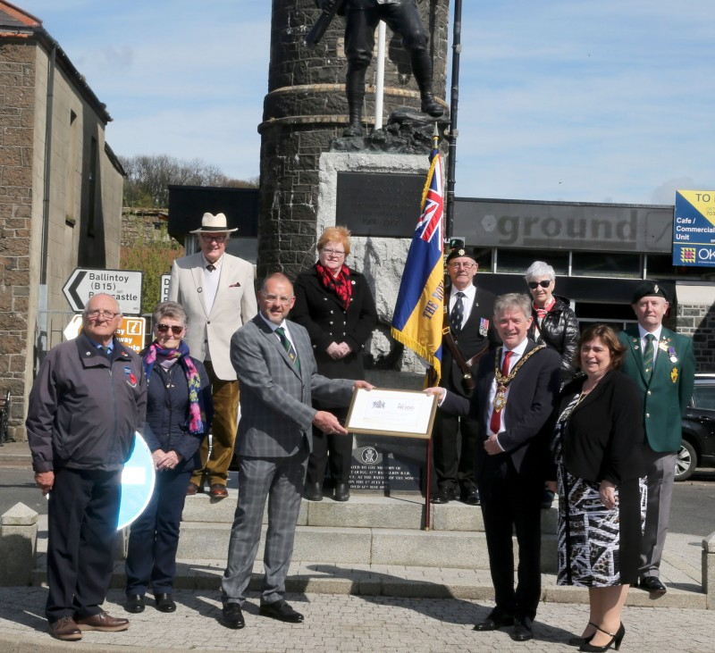 Members of Bushmills Royal British Legion receive a framed centenary certificate from the Mayor of Causeway Coast and Glens Borough Council Alderman Mark Fielding and Mayoress Mrs Phyliss Fielding.