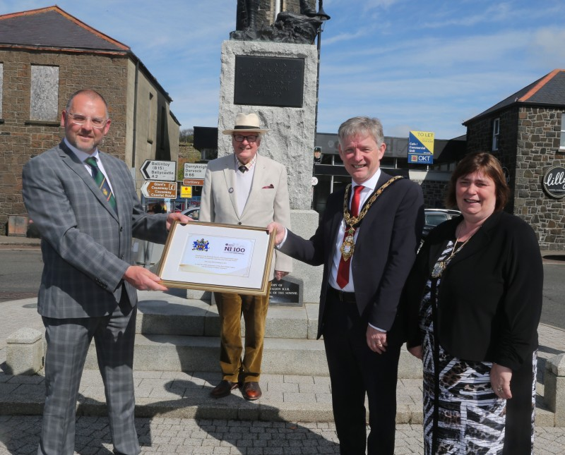 Mark Heaney, Chairman of the Bushmills branch of the Royal British Legion and Jim Fairbairn, Branch President, receive a framed centenary certificate from the Mayor of Causeway Coast and Glens Borough Council Alderman Mark Fielding and Mayoress Mrs Phyliss Fielding.
