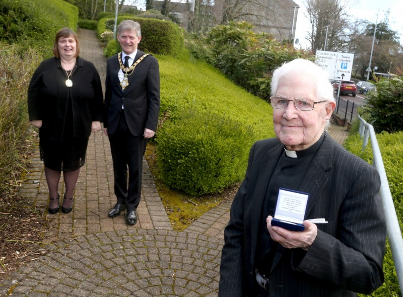 Canon Robert Wilkinson, who celebrated his 100th birthday on March 24th 2021, pictured with his commemorative centenary coin received from the Mayor of Causeway Coast and Glens Borough Council Alderman Mark Fielding and Mayoress Mrs Phyllis Fielding.