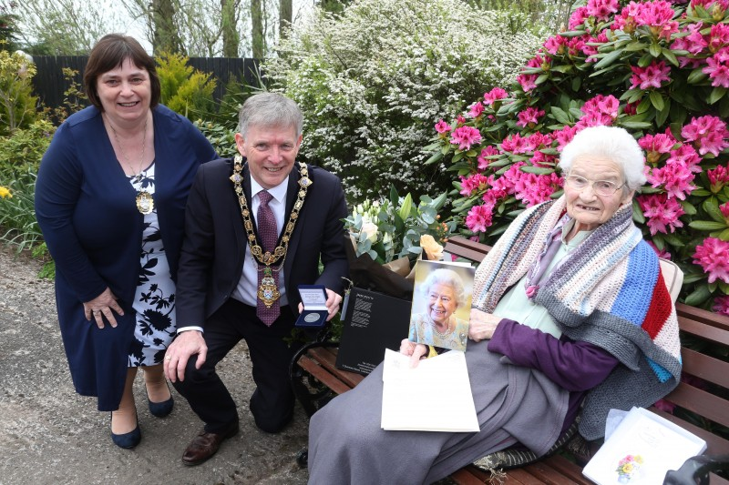 Margaret Mitchel, who celebrated her 100th birthday on 26th April 2021, receives her commemorative coin from the Mayor of Causeway Coast and Glens Borough Council Alderman Mark Fielding and Mayoress Mrs Phyllis Fielding.