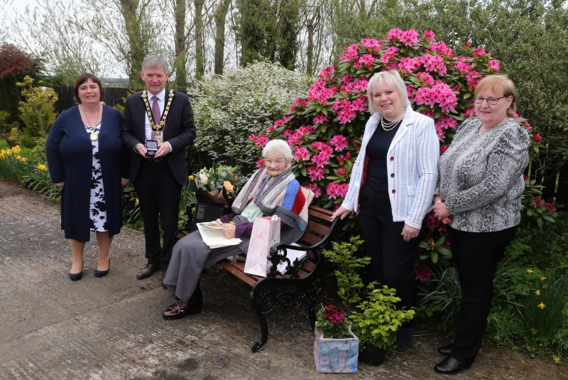 Margaret Mitchel receives her NI 100 commemorative centenary coin from the Mayor of Causeway Coast and Glens Borough Council Alderman Mark Fielding and Mayoress Mrs Phyllis Fielding, alongside Michelle Knight McQuillan and Lynda McAuley from Aghadowey Rural Kinship.