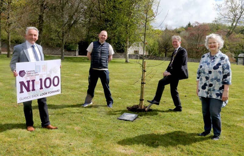 The Mayor of Causeway Coast and Glens Borough Council Alderman Mark Fielding plants a native oak tree at Cloonavin with Councillor William McCandless, Councillor Philip Anderson and Alderman Yvonne Boyle.