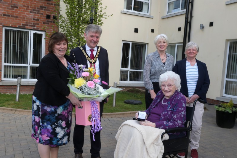 The Mayor of Causeway Coast and Glens Borough Council Alderman Mark Fielding and the Mayoress Mrs Phyliss Fielding present Edith Gilmore from Aghadowey with her centenary coin. Also pictured are Edith's daughters Mary Platt and Alison Cromie. Edith celebrated her 100th birthday on April 16th 2021.