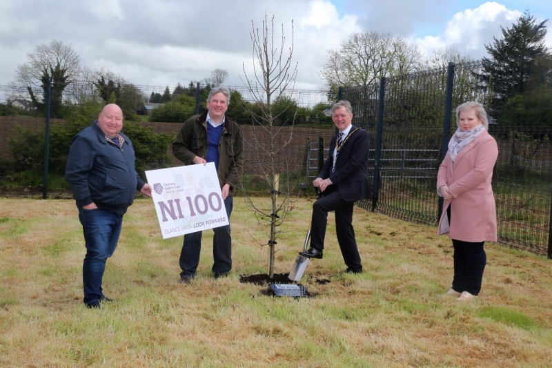 The Mayor of Causeway Coast and Glens Borough Council Alderman Mark Fielding plants a native oak tree at the Jim Watt Centre in Garvagh along with Councillor Adrian McQuillan, Councillor Richard Holmes and Councillor Michelle Knight McQuillan, Chair of Causeway Coast and Glens Borough Council's NI 100 Working Group.