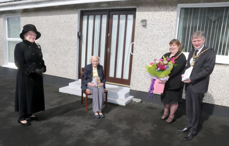 Isabelle Claypole, who celebrated her 100th birthday on April 10th 2021, receives her commemorative centenary coin from the Mayor of Causeway Coast and Glens Borough Council Alderman Mark Fielding and Mayoress Mrs Phyllis Fielding. Also included in the pictured is Lady Karen Girvan