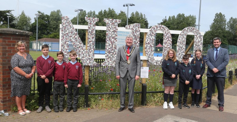 The Mayor of Causeway Coast and Glens Borough Council Councillor Richard Holmes pictured with pupils and staff from Millstrand Primary School and Culcrow Primary School who helped create the NI 100 mosaics now on display at Anderson Park in Coleraine.