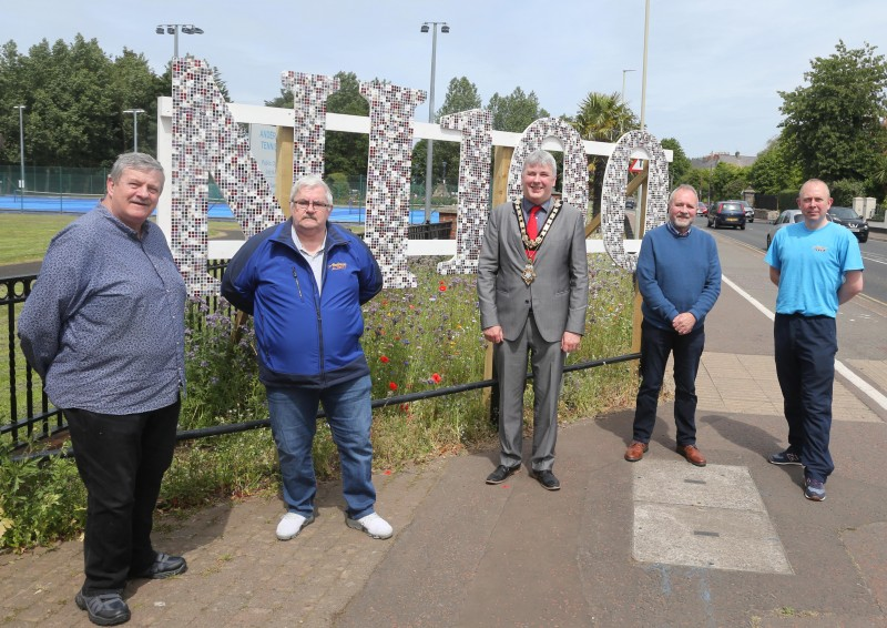 The Mayor of Causeway Coast and Glens Borough Council Councillor Richard Holmes pictured with Robert McIlreavey John McIlreavy, John Proule and artist Philip Anderson.