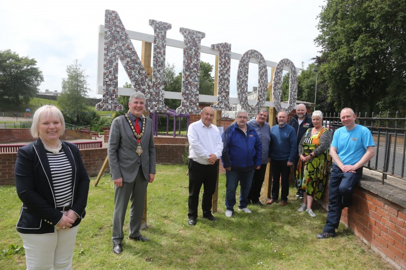 The Mayor of Causeway Coast and Glens Borough Council Councillor Richard Holmes pictured with Councillor Michelle Knight McQuillan, Chair of Causeway Coast and Glens Borough Council's NI 100 Working Group, representatives of Coleraine Festival Committee and artist Philip Anderson (right).