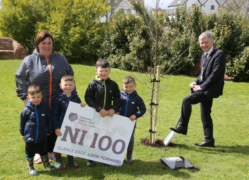 The Mayor of Causeway Coast and Glens Borough Council Alderman Mark Fielding plants a native oak tree at Flowerfield Park in Portstewart with Mayoress Mrs Phyllis Fielding and their grandchildren Tommy, Harvey, Jack and Freddie.