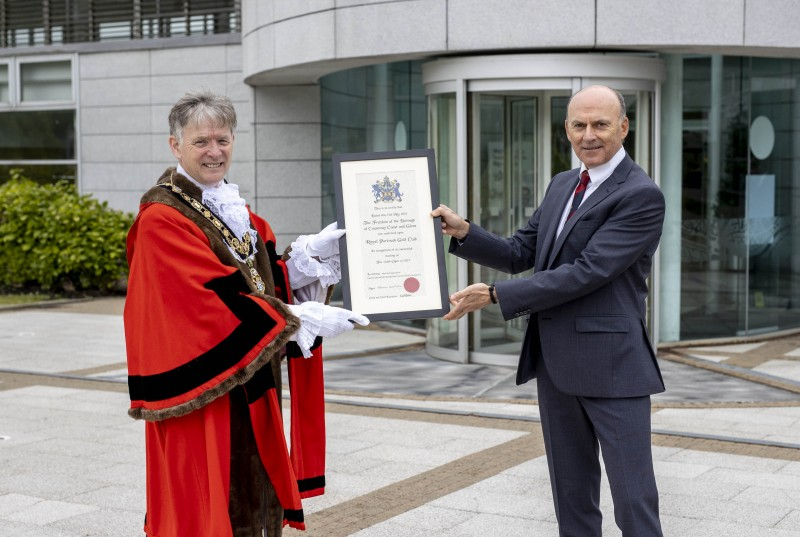 The Mayor of Causeway Coast and Glens Borough Council Alderman Mark Fielding presents the Freedom of the Borough certificate to Dr Ian Kerr, Captain of Royal Portrush Golf Club following the ceremony held in Cloonavin on Friday 21st May 2021.