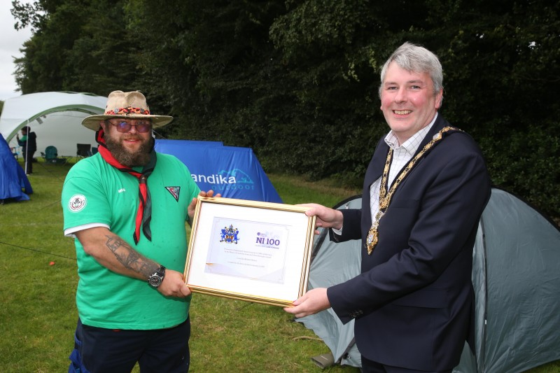 The Mayor of Causeway Coast and Glens Borough Council Councillor Richard Holmes makes a special presentation to Jonny Hoy, Group Scout Leader of Ballymoney Scout Group to mark 100 years of scouting in Ballymoney.