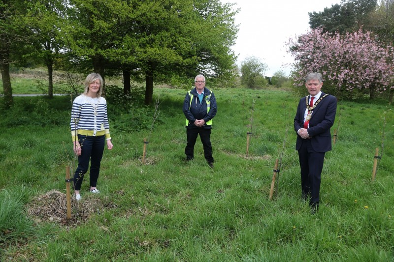 The Mayor of Causeway Coast and Glens Borough Council Alderman Mark Fielding pictured at Riverside Park in Ballymoney where 25 trees have been planted to mark the centenary of Soroptimist International with President Pamela Smyth and Kenny Henry from Conservation Volunteers.