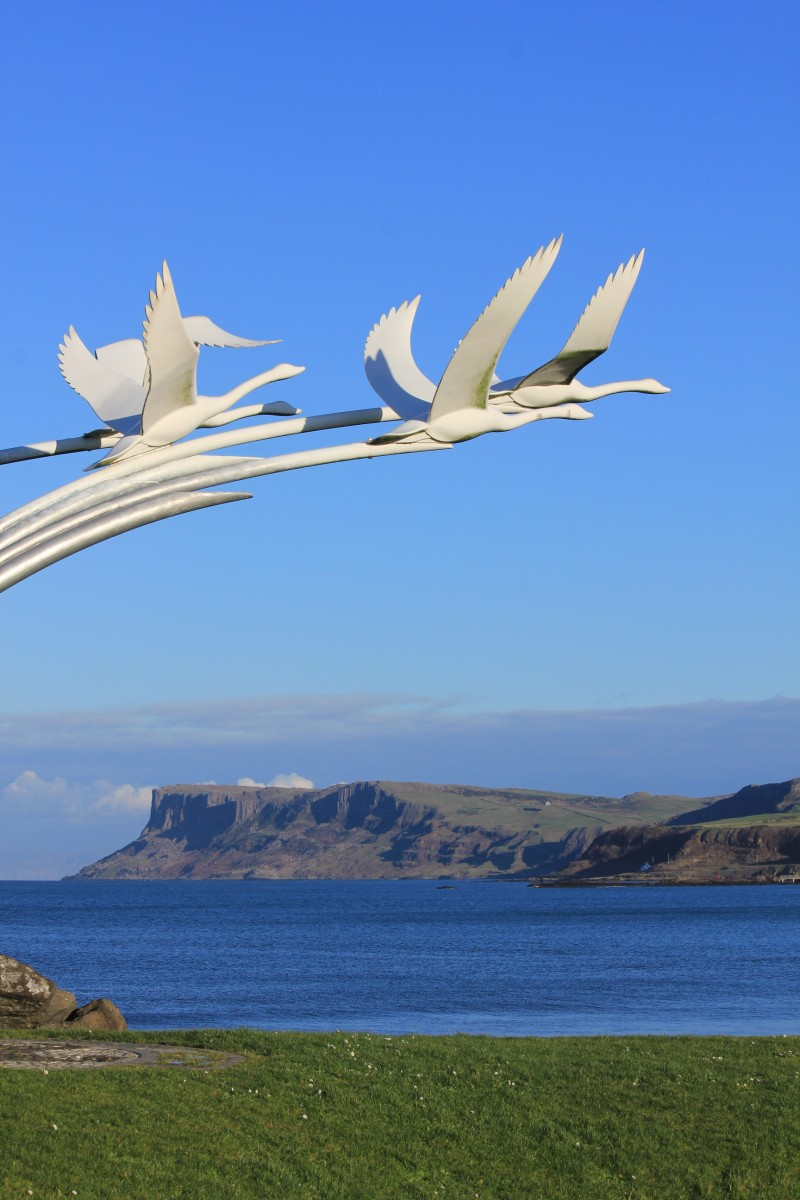 'Children of Lir' sculpture on Ballycastle seafront overlooking beach