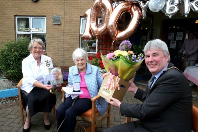 Centenary coin presented to Isobel Costine on her 100th birthday