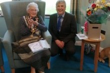 Centenarian receives bespoke coin from Mayor of Causeway Coast and Glens Borough Council