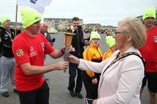 Mayor welcomes Special Olympics Flame of Hope to Portrush